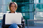 African american business woman with computer — Stock Photo
