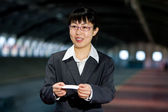 Asian business woman with calling card — Stock Photo