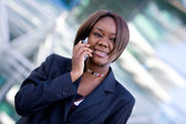 African american business woman with phone — Stock Photo