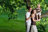 Happy perfect young family — Stock Photo