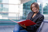 African american business woman with folder — Stock Photo