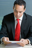 Smart eurasian business man browsing documents — Stock Photo