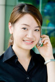 Asian business woman with phone — Stock Photo