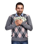 Happy young businessman holding a lot of one hundred dollar bill — Stock Photo