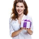 Brunette european girl with present — Stock Photo #27407677