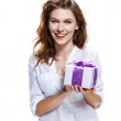 Brunette european girl with present — Stock Photo