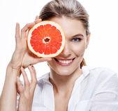 Smiling brunette european woman with mottled orange slice - isolated on white background — Stock Photo