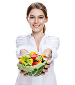 Merry european woman & vegetable salad - isolated on white background — Stock Photo