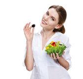 Buxom european woman & vegetable salad - isolated on white background — Stock Photo