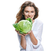 Young beautiful woman with cabbagehead in hand isolated on white background — Stock Photo