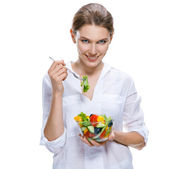 Young beautiful woman with vegetable salad bowl and fork in hand isolated on white background — Stock Photo