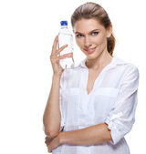 Smiling beautiful woman with bottle of water isolated on white — Stock Photo