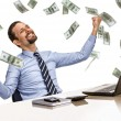 Young modern businessman excited with his success while working with his laptop computer with money rain — Foto de Stock