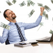 Young modern businessman excited with his success while working with his laptop computer with money rain — Stock Photo