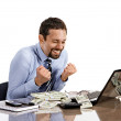 Young modern businessman excited with his success while working with his laptop and accounting income — Stock Photo
