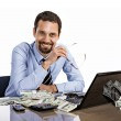 Successful smiling businessman with a lot of dollar stacks at the desk isolated on white background — Stock Photo #28590843