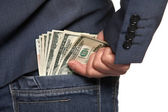 Male hand draws out a money from the pocket of jeans, close-up — Stock Photo