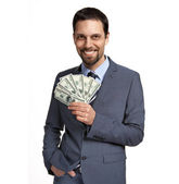 Successful businessman holding money - isolated over a white background — Stock Photo