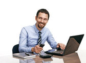 Successful businessman going to make a call by cellphone while working with laptop isolated on white — Stock Photo
