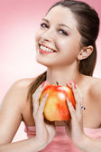 Young beautiful girl with an apple — Stock Photo