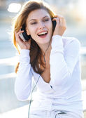 Delightful young woman taking her headphones off — Stock Photo