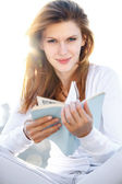 Delightful young woman holds the book — Stock Photo