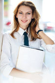 Delightful young woman holds the folder — Stock Photo