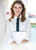 Young woman holds folders — Stock Photo