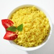 Looking down at a bowl of yellow rice dish — Stock Photo #31834283
