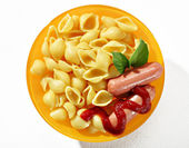 Baked macaroni shells & sausages — Stock Photo