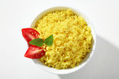Looking down at a bowl of yellow rice dish — Stock Photo