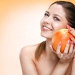 Precious woman with orange fruit — Stock Photo