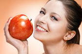 Appealing woman with apple — Stock Photo