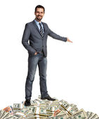Happy businessman shows the way how to make a lot of money — Stock Photo