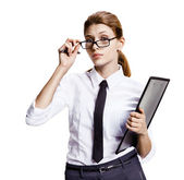 Surprised woman looking over glasses — Stock Photo