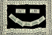 Smiley face in dollar bill frame — Stock Photo