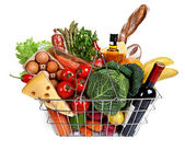 Metal shopping basket with groceries — Stock Photo