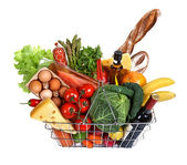 Metal shopping basket with foods — Stock Photo