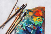 Oil paints picture and paint brushes — Stock Photo