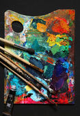 Painting brushes and palette — Stock Photo