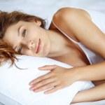 Awakening women in bed — Stock Photo