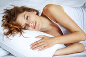 Awakening women in bed — Stock Photo