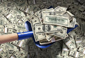 Money with shovel — Stock Photo