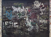 Graffiti on garage doors — Stock Photo