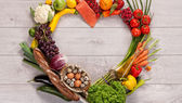Heart shape by various vegetables and fruits — Stock Photo
