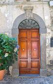 Wooden door. Bolsena. Lazio. Italy. — Stock Photo