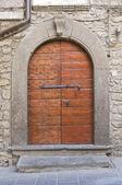 Wooden door. Vitorchiano. Lazio. Italy. — Stock Photo