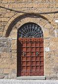 Wooden door. Orvieto. Umbria. Italy. — Stock Photo