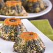 Spinach cakes on white dish. — Foto de Stock