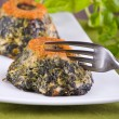 Spinach cakes on white dish. — Stock Photo